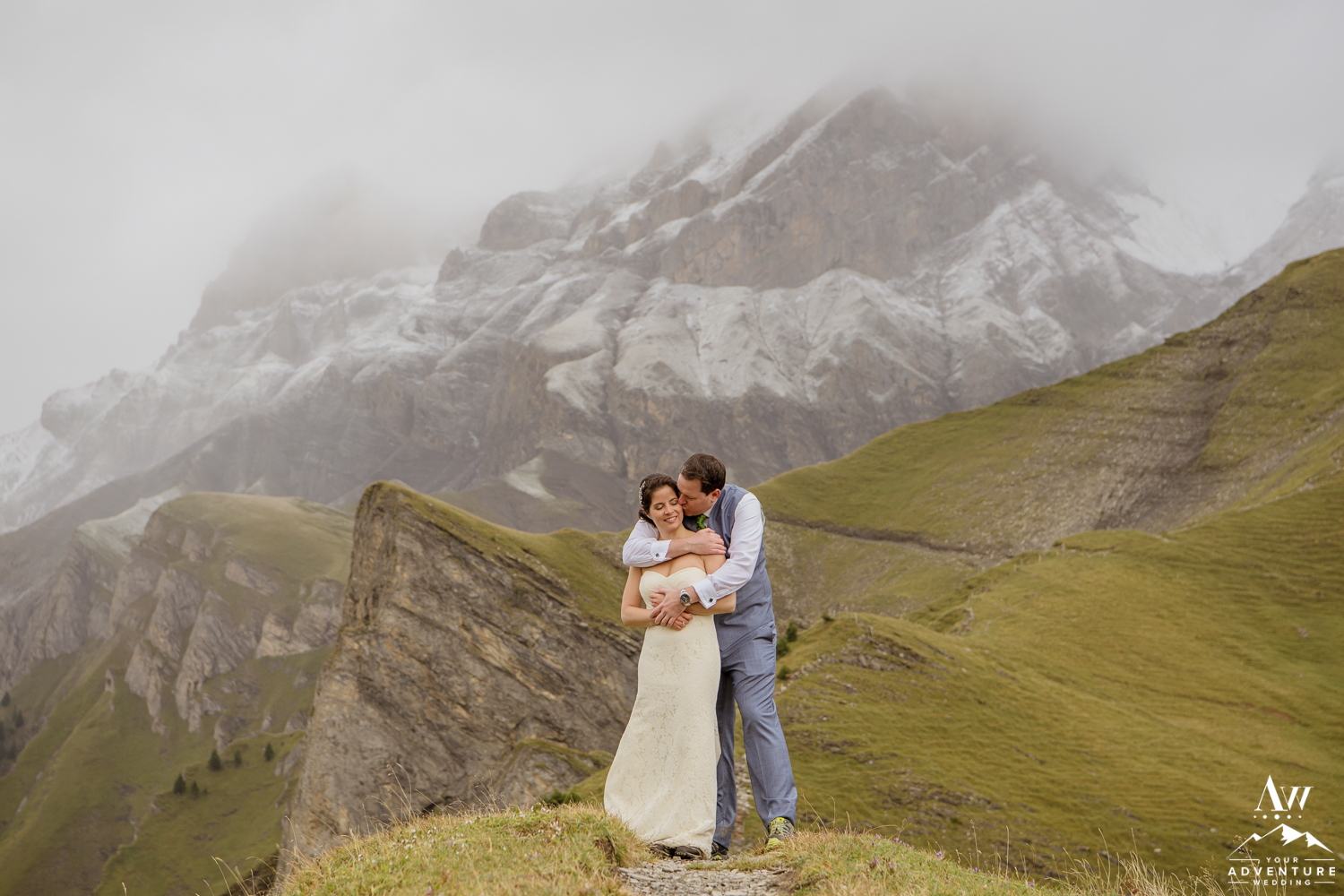 Couple hugging during adventure wedding in Switzerland