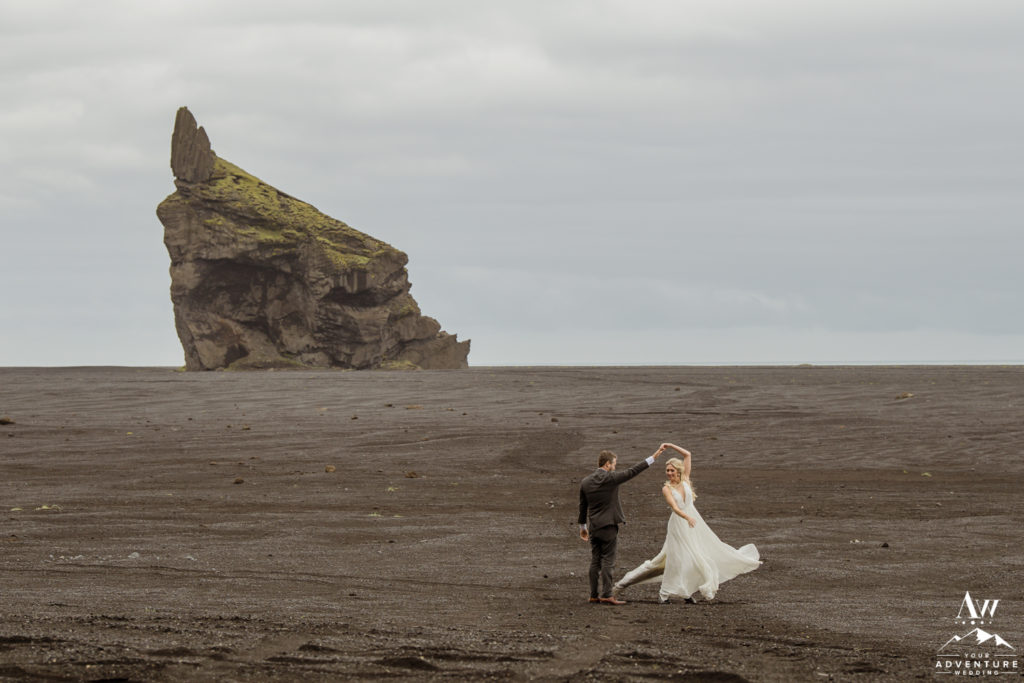 Iceland wedding couple dancing on a black desert