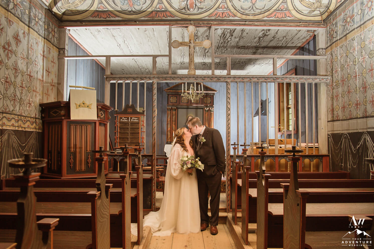 Norway Elopement Couple kissing inside Eidsborg Stave Church