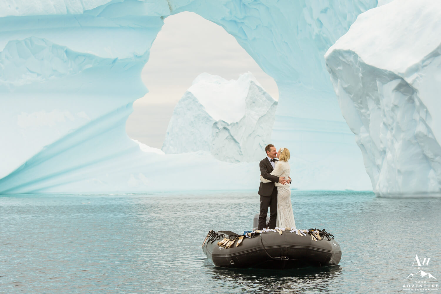 Couple kissing in a zodiac in Antarctica