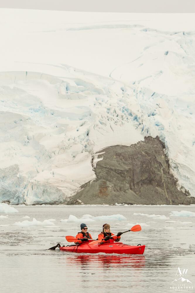 Antarctica elopement couple kayaking