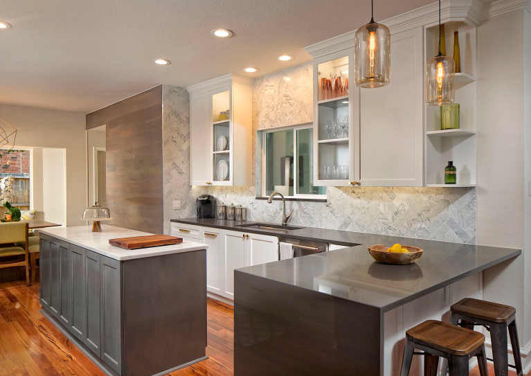 Transitional kitchen renovation with island and breakfast bar