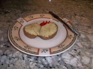 Potato cooked in the microwave using the Norpro potato feet holder.