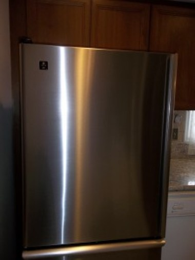 Stainless steel refrigerator after it was cleaned with Weiman stainless steel wipes.