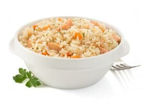 Bowl of rice with meat and vegetables.