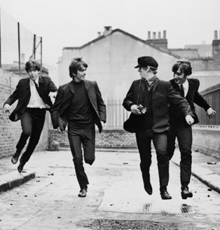 "The Beatles attempt to flee from their screaming fans in ""A Hard Day's Night"""