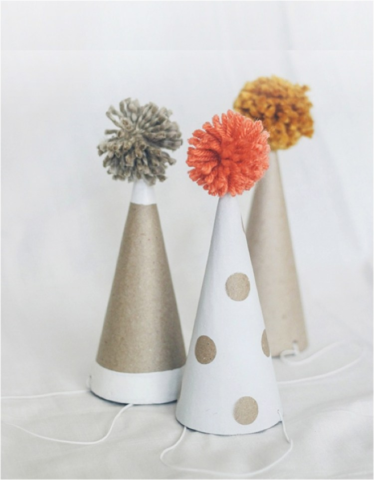 """DIY pompom kids party hats"""
