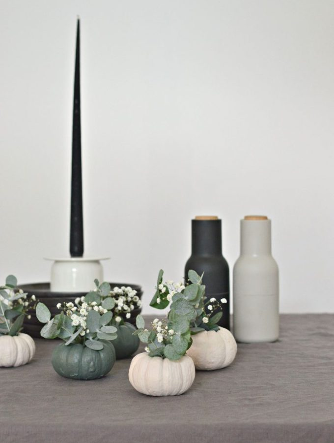 Decorate with DIY mini pumpkin vases this Halloween