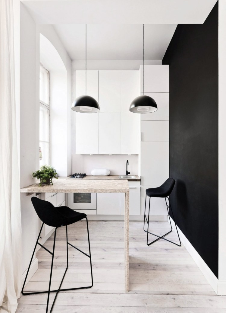 monochrome kitchen with wood floor