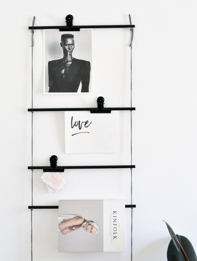 Display your art (and more) on this DIY hanging dowel ladder
