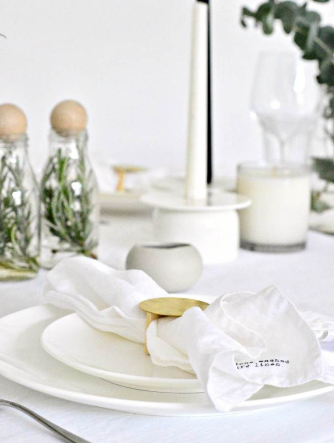 A simple Christmas table setting in white and green