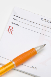image of a pen and prescription pad