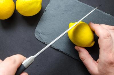 Cutting lemons.