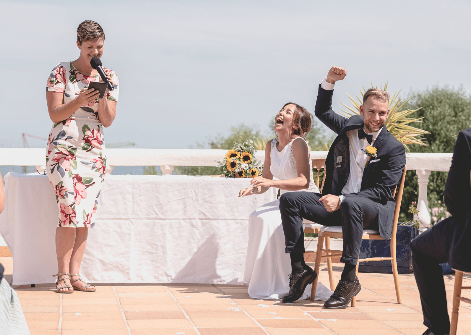 Celebrant speaking and bride and goorm laughing