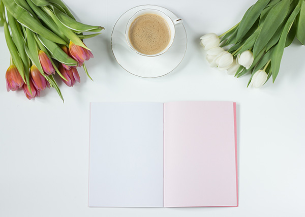 Notebook, coffee and flowers