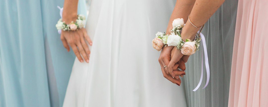 Bride & bridesmaids holding hands
