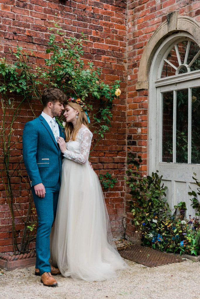 Bride & Groom in front of stylish door in the Walled Garden