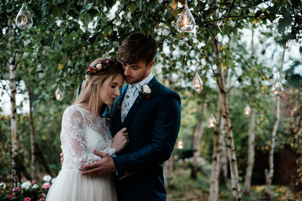 Bride & Groom with hanging tealights in trees