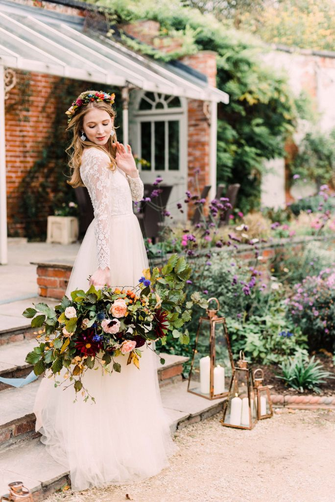 Bride with Bouquet on steps with copper lanterns