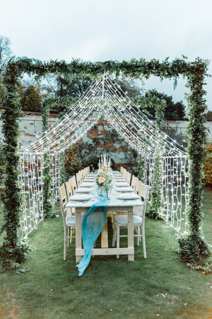 Fairylight installation over banquet table in the Walled Garden