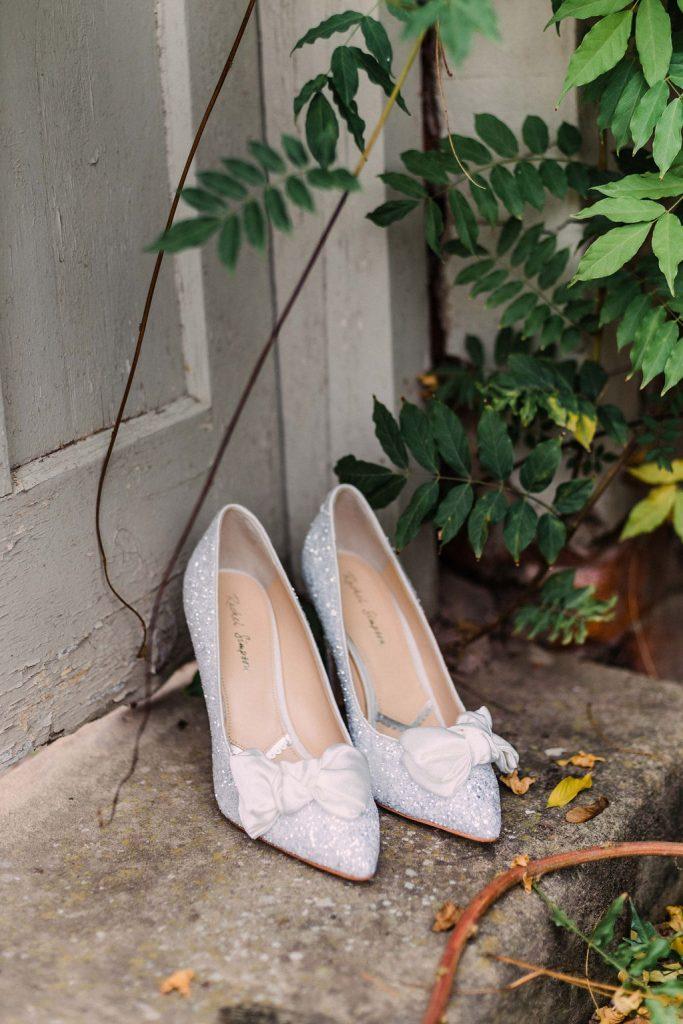 Sparkly Rachel Simpson Bridal Shoes against the wooden door in the Walled Garden