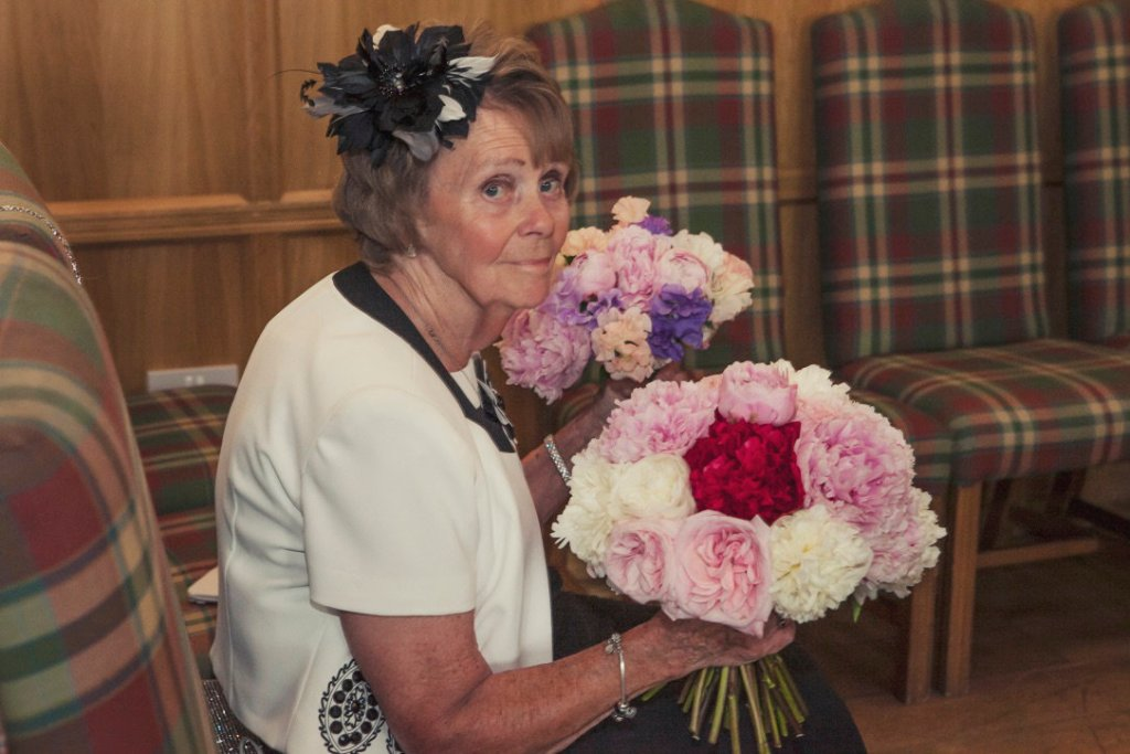 bride's mum holding bouquets