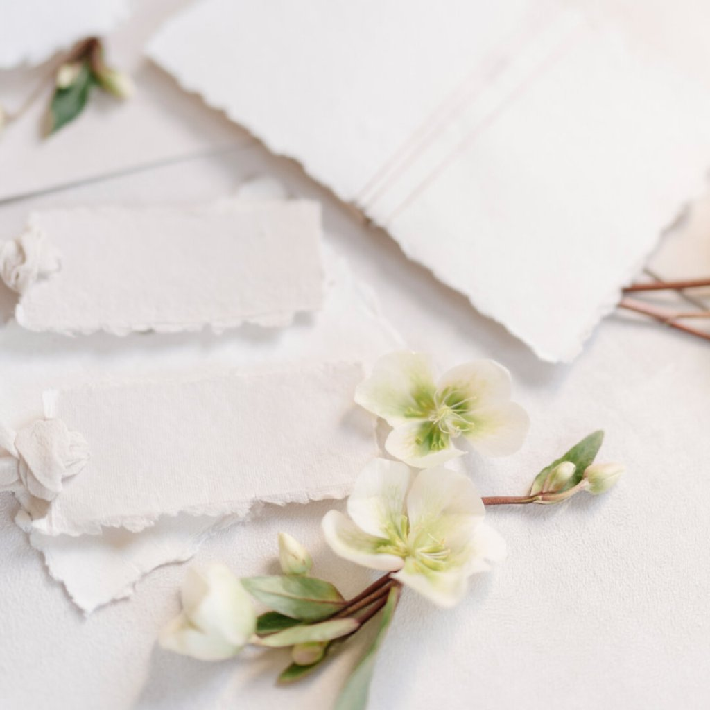 Delicate flowers with wedding stationery