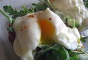 Peppery arugala compliments the mornay sauce and creamy yolks in this version of Eggs Benny.