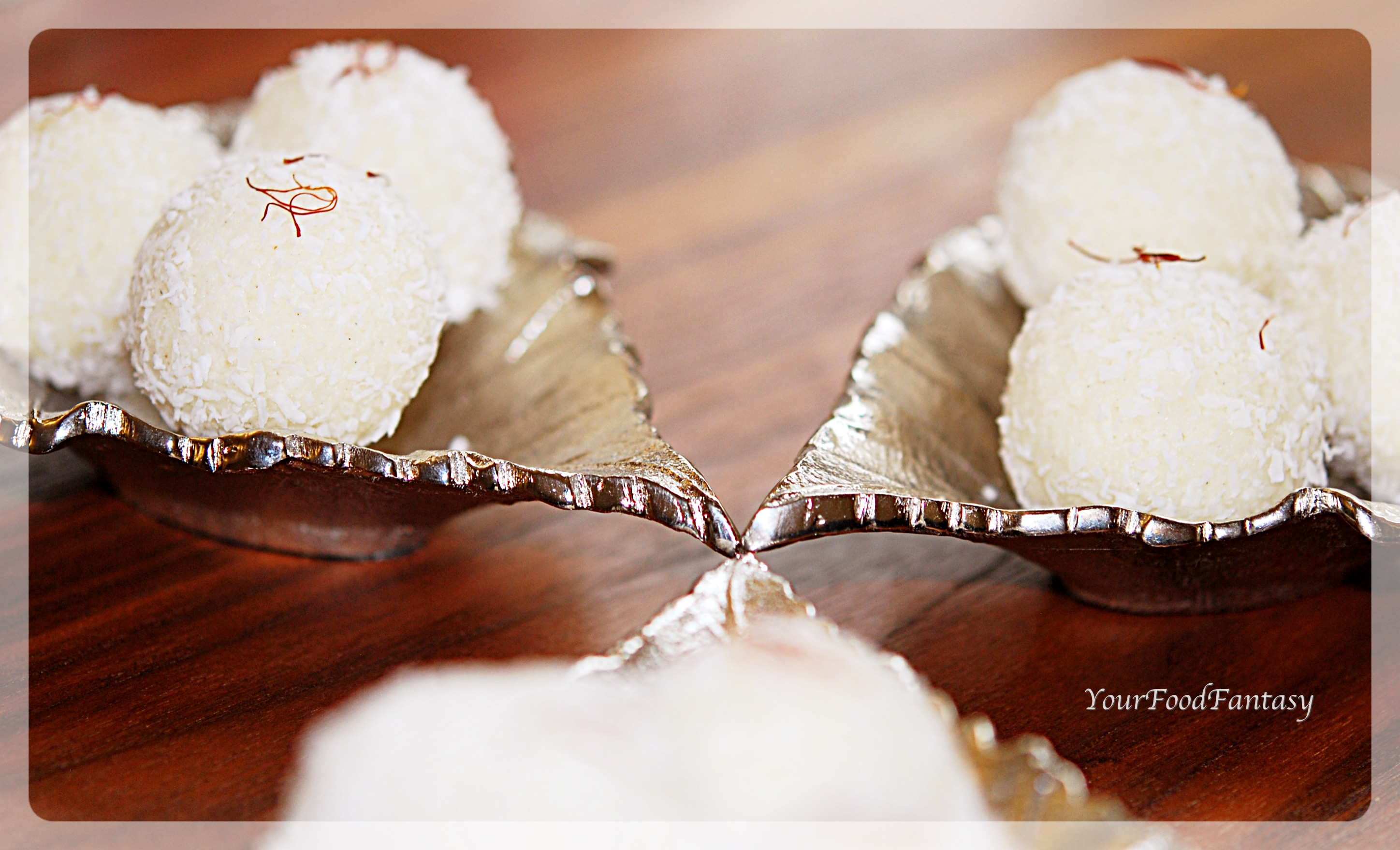 another picture of coconut ladoo with desiccated coconut at yourfoodfantasy.com