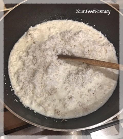 Adding grated coconut in the milk | Coconut Barfi