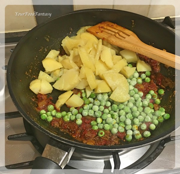 Adding Boiled Potato and Green Peas | YourFoodFantasy.com