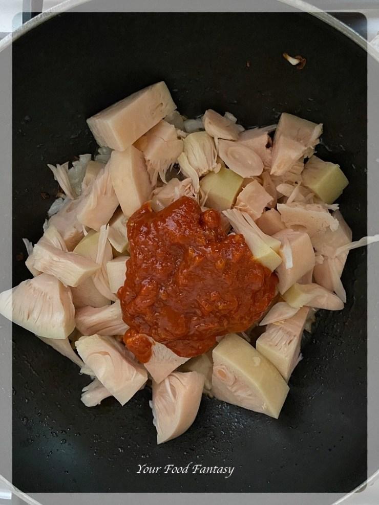 Adding Schezwan Sauce for Jackfruit Pulled Pork Recipe