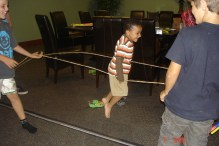 This was from a 'Jamaican' themed cookout that we had. SanJay is playing Chinese jump rope. Such a fun event!