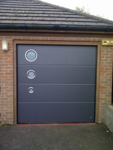 Ryternal Sectional garage door with round windows
