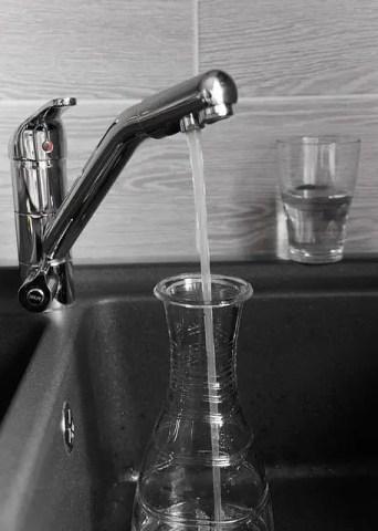 Faucet filling carafe