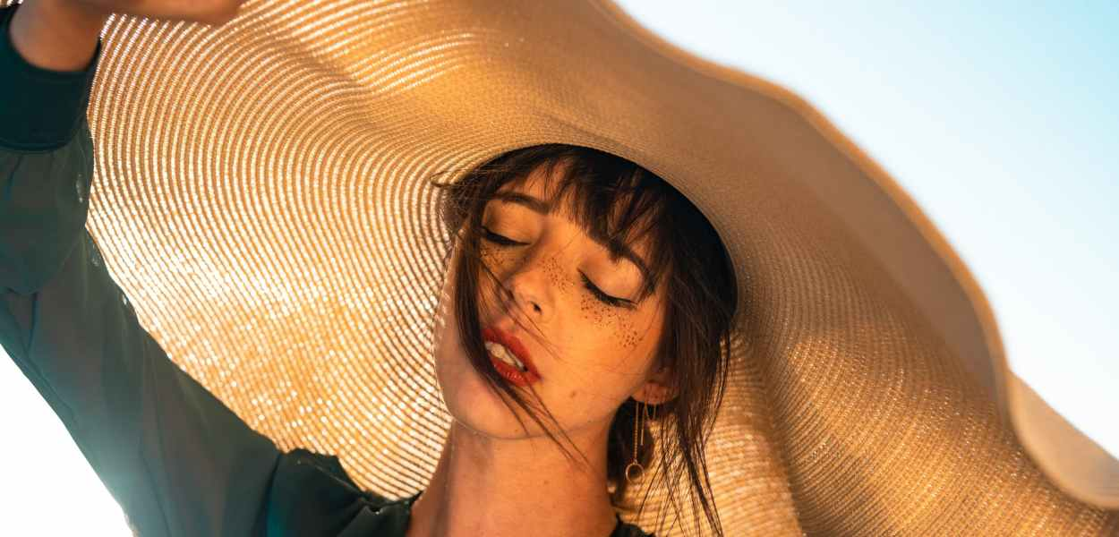 woman under brown hat