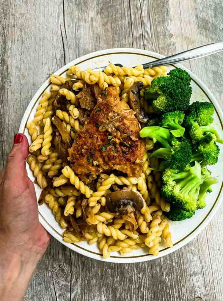 chicken marsala on plate with pasta and broccoli