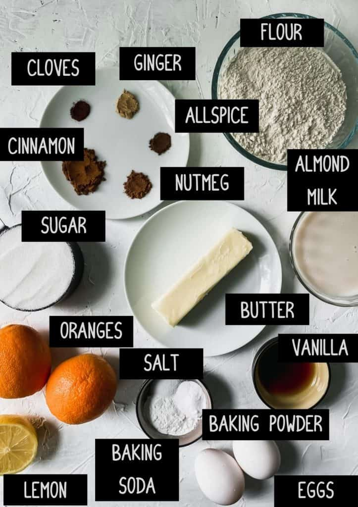 Ingredients for spiced orange muffins with labels (see recipe for details)