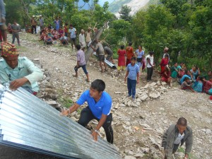 Villagers in Duskhun, Nepal, help each other rebuild