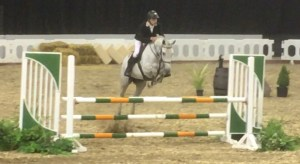 Grey pony Marilyns mist is jumping a fence at Millstreet 2017