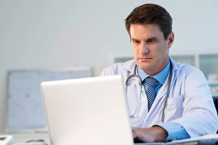 Doctor concentrating at computer