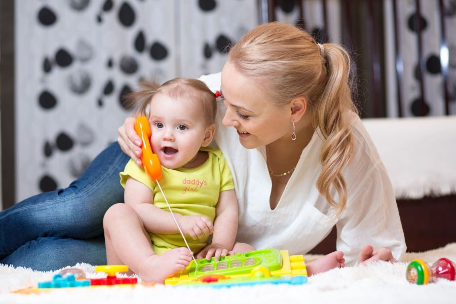 36834321 - child girl phone with mother playing with toy phone