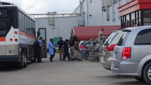 Detainees being moved by ICE agents