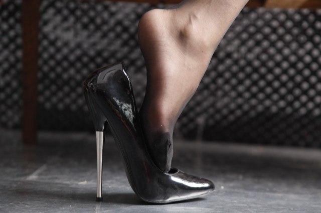 foot-coming-out-of-meta-heel-shoe