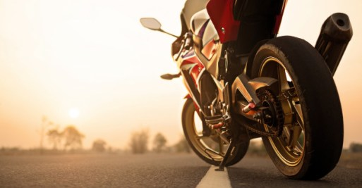 motorcycle-parking-road-right-side-sunset_38575-88