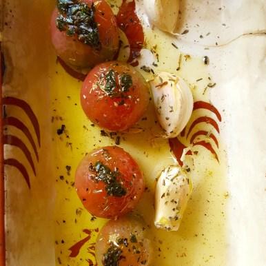Baked cherry tomatoes and fresh garlic