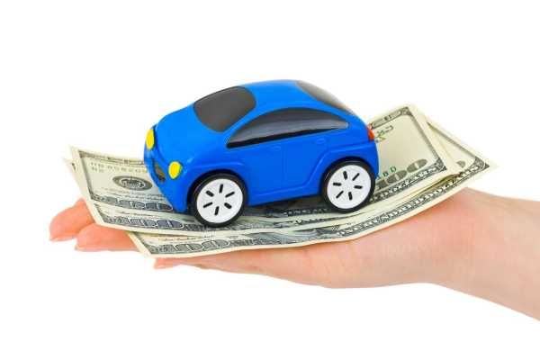 Hand with money and toy car