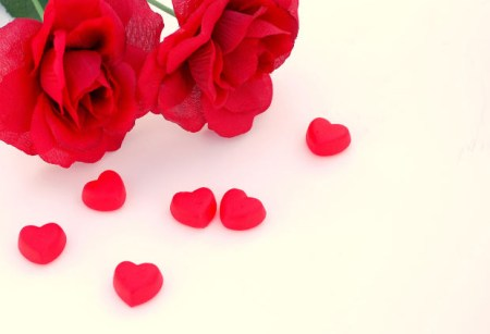 Love red roses and heart shaped candy