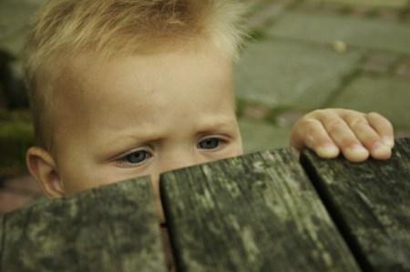 eyes-child-behind-wood