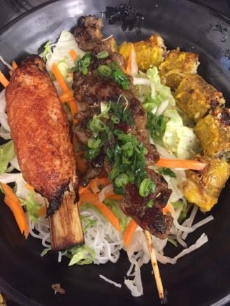 Pork, Spring Rolls, Supreme Shrimp on Sugar Cane with Noodles
